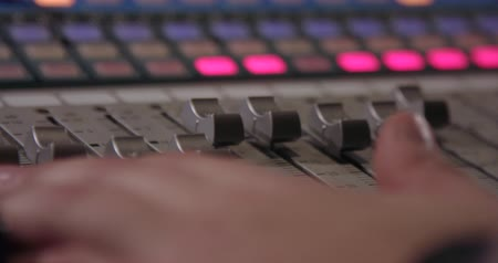 tárcsáz : Mixing Board. Sweeping across the master controls of a professional sound mixing board. Stock mozgókép