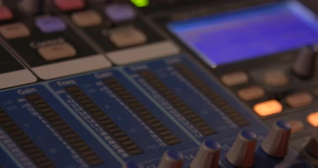 dengeleme : Mixing Board. Sweeping across the master controls of a professional sound mixing board. Stok Video