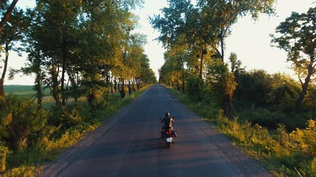 atv : Aerial: the hills of the Carpathians, the camera follows a motorcyclist on the highway, having fun and enjoying the road