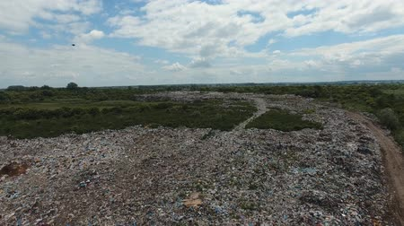 AERIAL: Big piles of empty bottles, bags and other plastic in the garbage dump