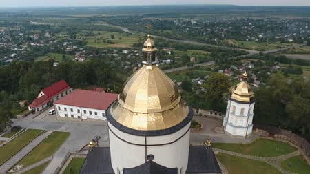 Aerial shot, flying over Goshiv Monastery, Ukraine Vídeos