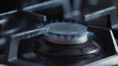 Open gas stove in kitchen with fire blade. Cooking dinner concept.