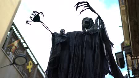 надгробная плита : Ghost in the street made from black fabric during the celebration of Halloween