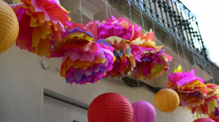 plaketa : multi-colored japanese street lanterns at entrance to store. street decoration