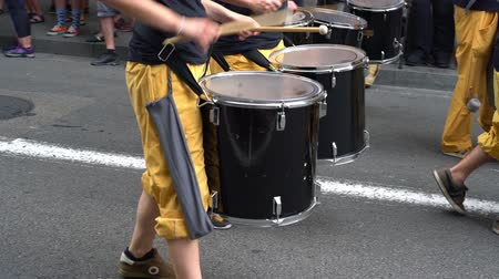tambourine : drummers walk down the street in parade Stock Footage