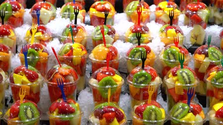 fruit smoothies in glasses in ice on the market. colorful fruits in ice