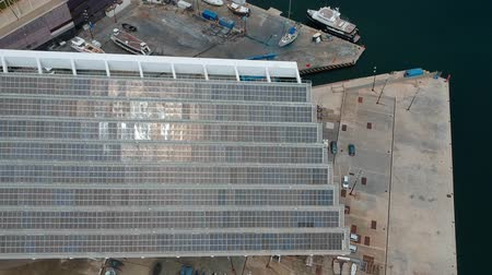 Aerial view of huge solar panel near the seaport. view from above