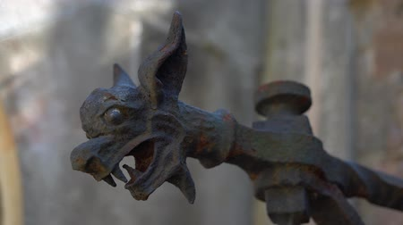 devil head made of metal. torch holder close up