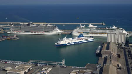 huge cruise ship enters the port of Barcelona, sunny day. view from above