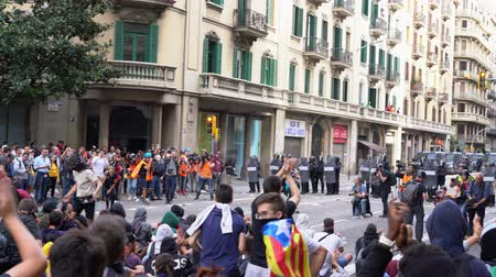 protestor : young people with the flags of Catalonia chant against the police cordon