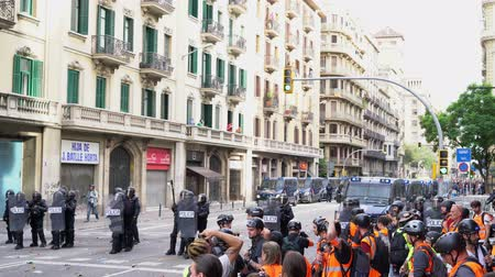 protestor : police cordon during a riot in Barcelona against of armored police cars