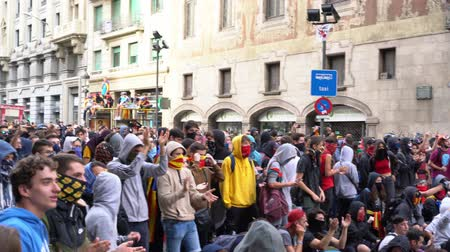 protestor : young people with flags of Catalonia sing songs on a blocked street during riot Stock Footage