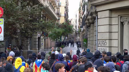 protestor : young people shout curses at the police on a blocked street in Barcelona