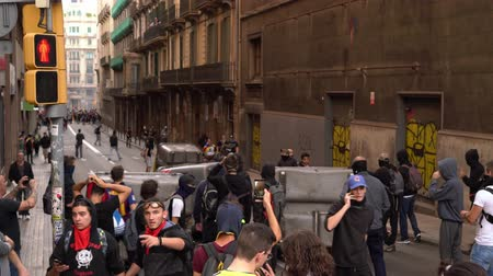 protestor : people build barricades during the riots in Barcelona from garbage containers.