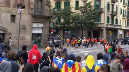 protestor : protesters people with flags of catalonia against police and tv reporters