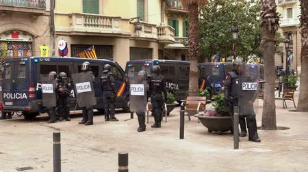 patrol : Police cordon on the street of Barcelona during mass protests Stock Footage