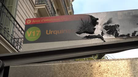 protestor : burned-out sign at the bus stop with the inscription Urquinaona Stock Footage