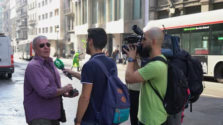 protestor : reporters interview a man who witnessed the riots in Barcelona October 18, 2019