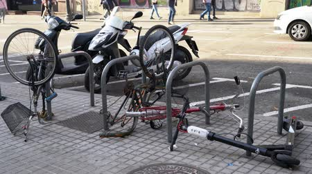 protestor : broken bikes and scooters in a bicycle parking