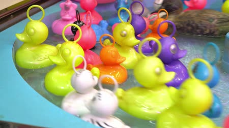 colorful rubber ducks in the pool at the Christmas market float in circles