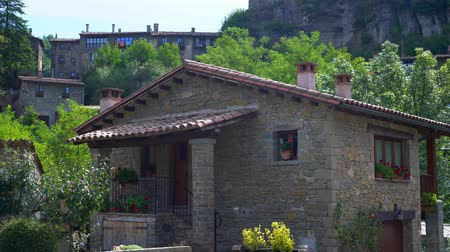 stone house in a village on a background of high mountains