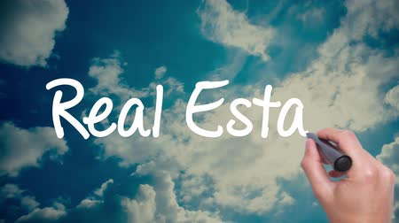 владелец : Real Estate -  cloud with a blue sky. Man Hand writing  with black marker on the sky. Red circled. Amazing Time Lapse blue sky clouds and sun shining. Big dreams, hopes and aspirations. 4k Стоковые видеозаписи