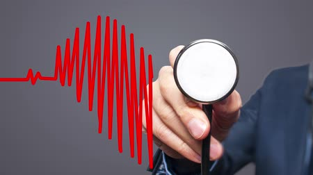 Closeup of hand with Stethoscope checking heart beat in heart shape. Health, business, Preventive medicine concept. 4k