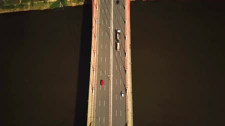 AERIAL: Freight truck driving over the viaduct highway. Camera following truck. City View; Dostupné videozáznamy