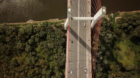 Transportation Aerial of Cars on Big Bridge with Tall Pillars Crossing Large River;