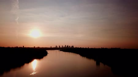 Beautiful sunset to night transition over city of Warsaw downtown skylin. Over Vistula River;