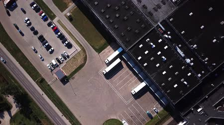 Truck is Driving to Logistics Center. Aerial Shot. Unloading cargo