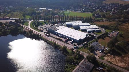tesisler : Aerial Shot Of Logistics Center With Trucks. Lake Nature.