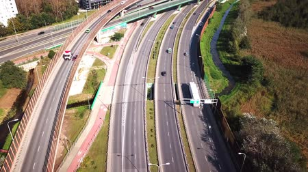 Truck on the road. Large delivery truck is moving towards crossroads. Aerial shot.