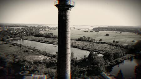 Aerial shot of a old chimney with 1919 sign on it. Black anw white Dostupné videozáznamy