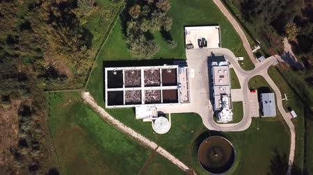 clarifier : Aerial top down view flying over wastewater treatment plant also known as sewage treatment plant or sewage treatment works plant for sewage treatment process removing contaminants from wastewater 4k