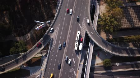 Aerial shot focuses on Bus crossing the bridge, traffic on the bridge. Cars driving. 4K. Crossroads