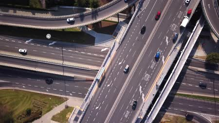 Aerial high drone flight over road traffic. Highway and overpass with cars and trucks, interchange, two-level road junction in the big city. Top view.
