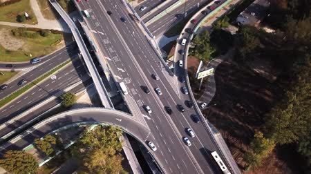 oroszország : Aerial high drone flight over road traffic. Highway and overpass with cars and trucks, interchange, Following traffic jam. 4K