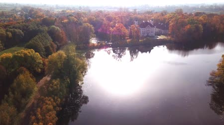 rytíř : Flying over the beautiful Castle in autumn Forest. Located in landscape park with green trees forests in autumn. 4K Aerial View.