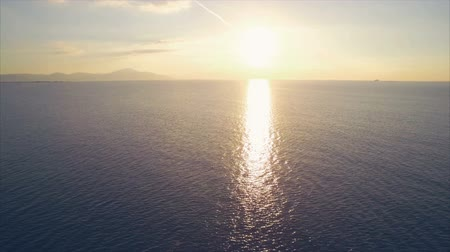 drone : Aerial drone footage of beautiful ocean during sunset.