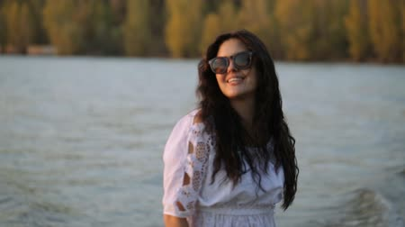 haj : girl posing and smiling at sunset,walk along the river Stock mozgókép