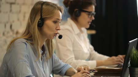 irodaház : Two beautiful businesswoman working in call center