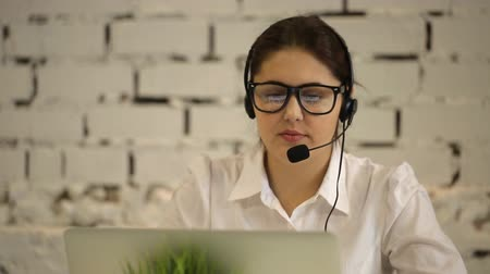 képviselő : positive girl working in the call center and tired Stock mozgókép