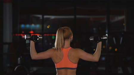 fit : woman doing exercise with dumbbells on shoulders