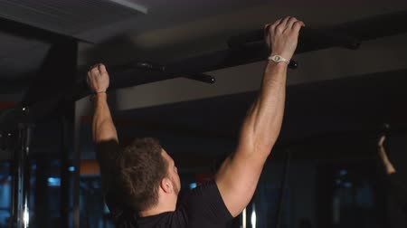 focus pull : man doing pull UPS Stock Footage