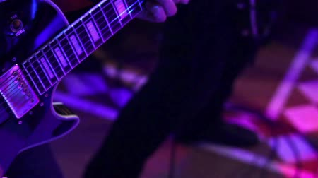 musicians stage : Man playing the guitar at a concert Stock Footage