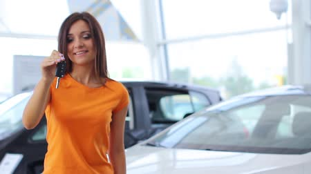 new car : Girl selling car at car sales center (PAL) Stock Footage