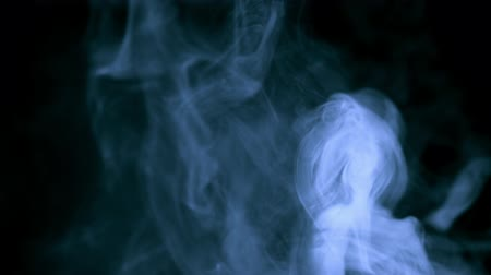 bewerken : Blue smoke on black background
