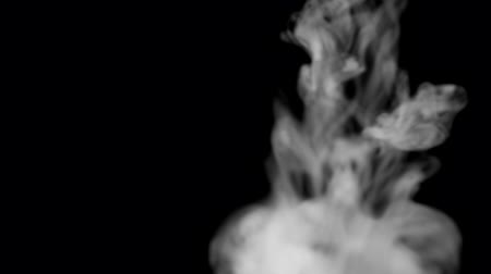 condensacion : White smoke on black background