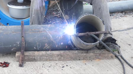oxyacetylene : Welder uses torch for welding pipe metal on site. Stock Footage